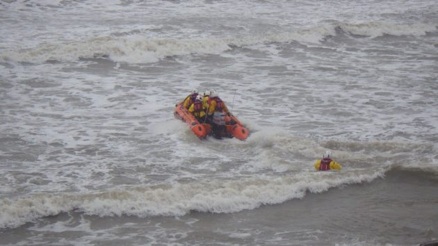 an inshore lifeboat from Port Talbot is launched in heavy seas