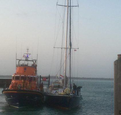 An all weather lifeboat helps the former BT Global Challenge yacht, Elinca