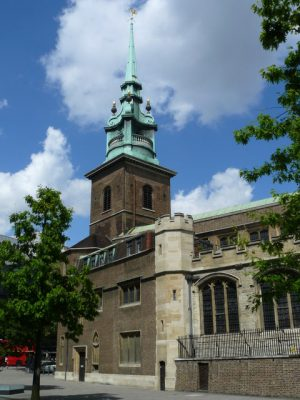 A church with a green spire in London where a memorial service is held each year to remember all those lost at sea