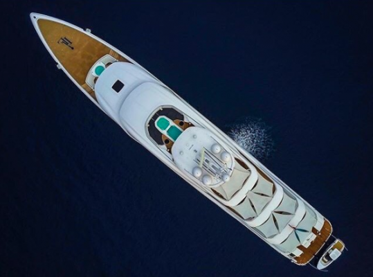 An aerial view of a white and wooden superyacht