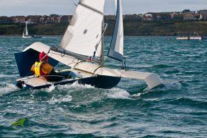 A man in a boat taking part in Weymouth Speed Week