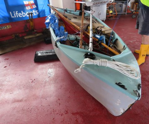 A turquoise and white Gull dinghy