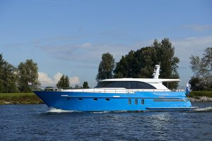 A blue and white motor yacht on the water