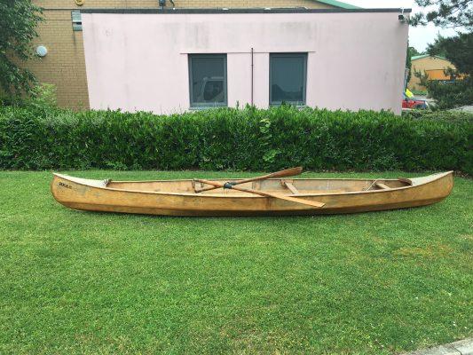 wooden canoe in the backyard