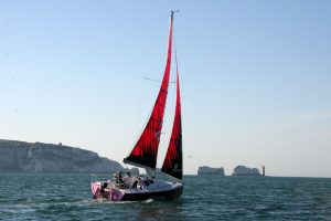 Natasha Lambert BEM sailing on her Miss Isle Too boat