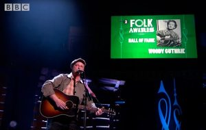 "Watch Billy Bragg cover Woody Guthrie's ""I Ain't Got No Home"" at the BBC Radio 2 Folk Awards"