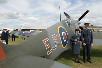 The Spitfire MKXIV attracts appropriately kitted admirers