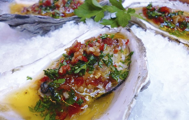 Grilled oysters with parsley, lemon and bacon