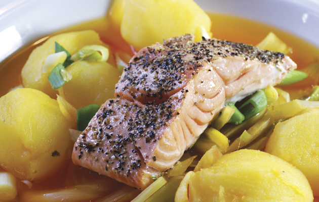 Peppered salmon with saffron potatoes and spiced broth.