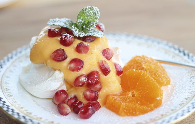 Tangerine curd and pomegranate meringues