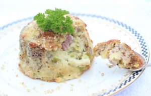 Double baked bacon and Stilton soufflé with crushed walnuts