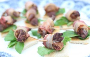 Dried fig, pigeon breast and smoked bacon skewers on toast