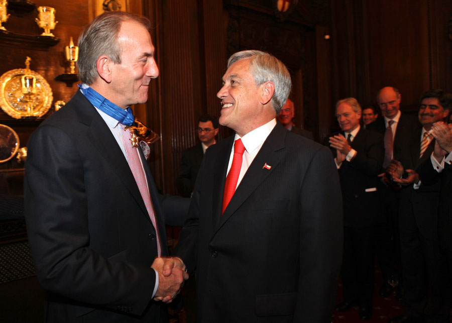 Michael Cox and Chilean president Sebastian Pinera