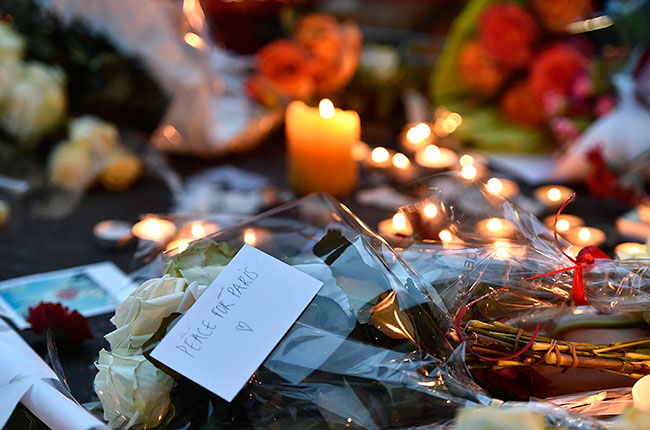 Paris attacks: Candles and flowers at Bataclan theatre