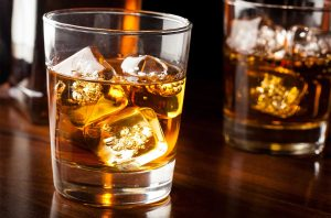 A glass of whisky with ice
