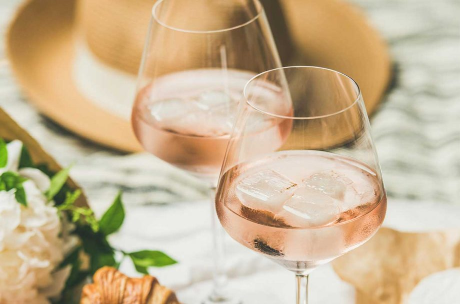 Two glasses of rose wine with ice cubes in