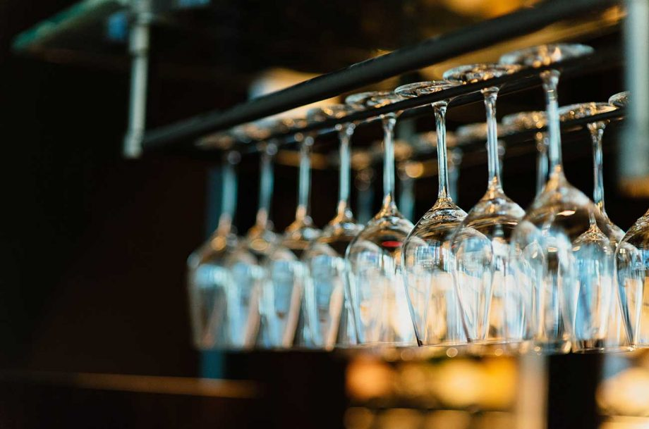 Restaurant wine glasses waiting to be served; how confidently can you order wine in a restaurant?
