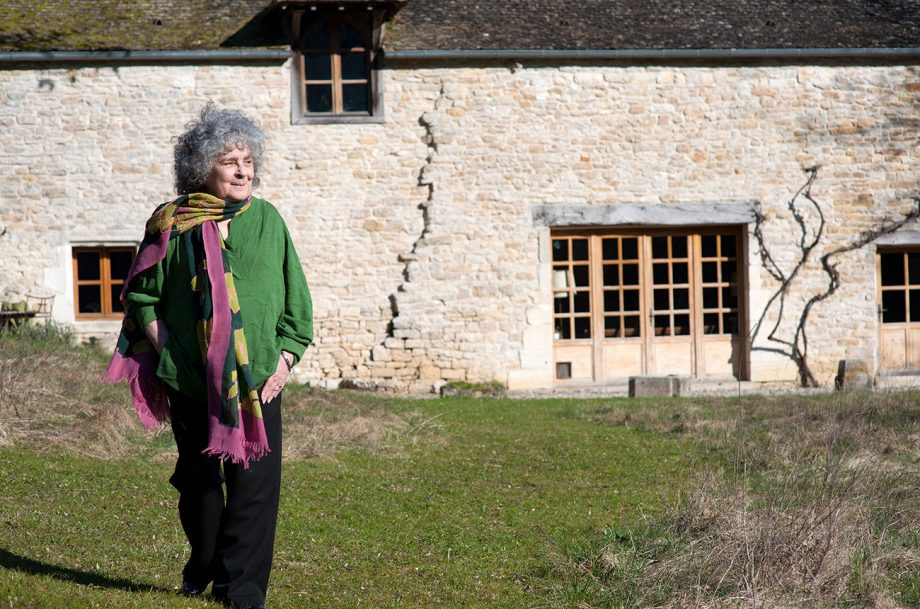 Becky Wasserman-Hone in front of farmhouse