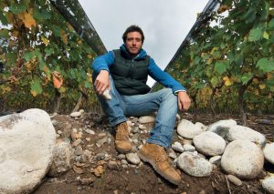 Sebastián Zuccardi sitting in one of the family's Malbec vineyards in the Uco Valley, Argentina