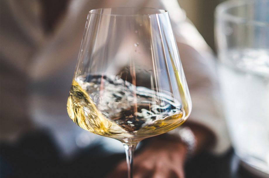 A glass of Sancerre swirling
