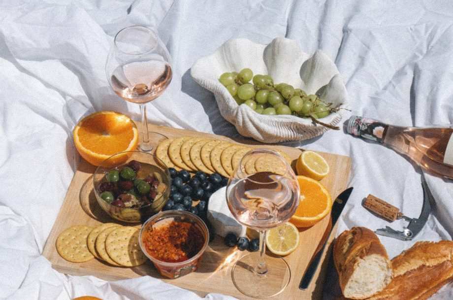 a picnic with wine, olives, baguette and more