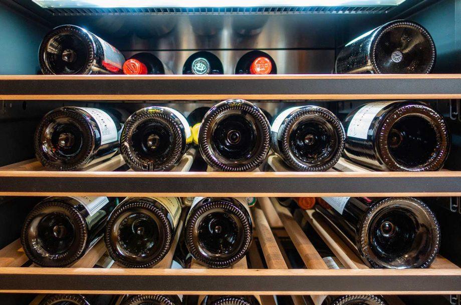 Bottles of wine in a wine fridge