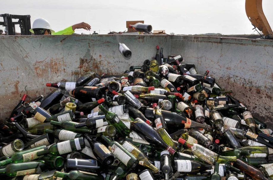 Counterfeit wines once belonging to Rudy Kurniawan being destroyed in Texas in 2015.
