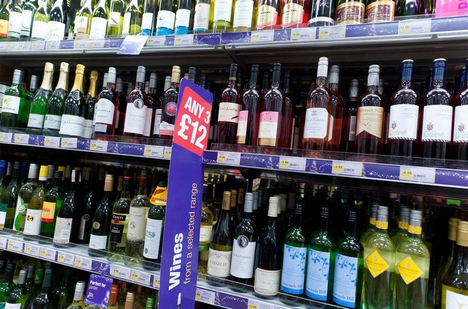 Bottles of wine on a supermarket shelf