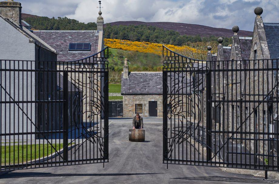 Master Distiller Stewart Bowman rolls a whisky barrel through the gates at Brora Scotch Whisky Distillery