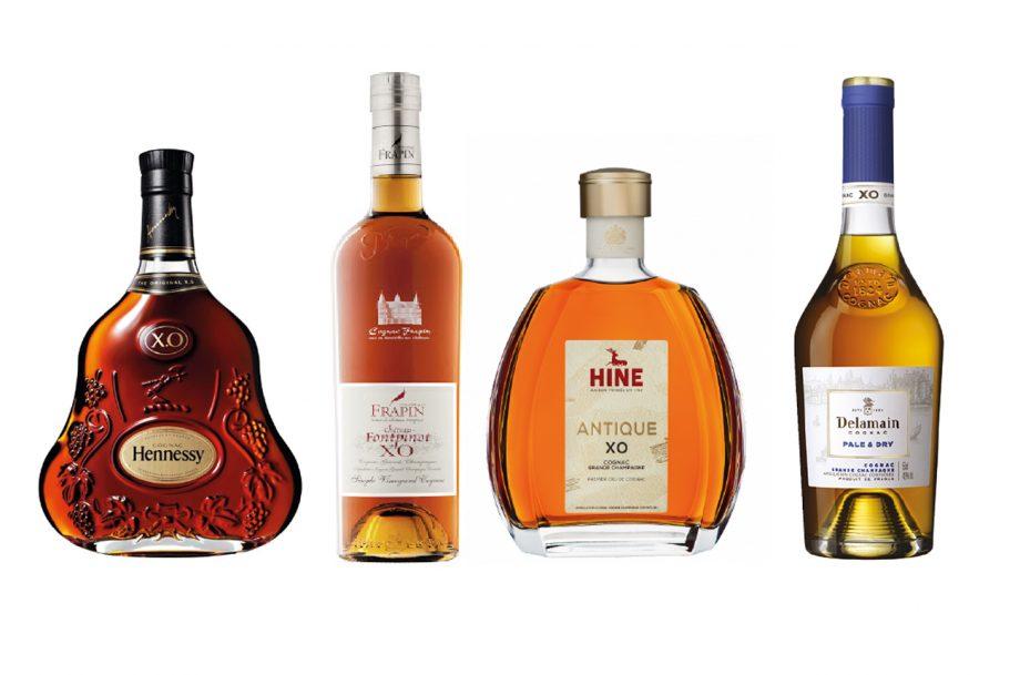 Four XO Cognac bottles: Hennessy, Frapin, Hine, Delamain
