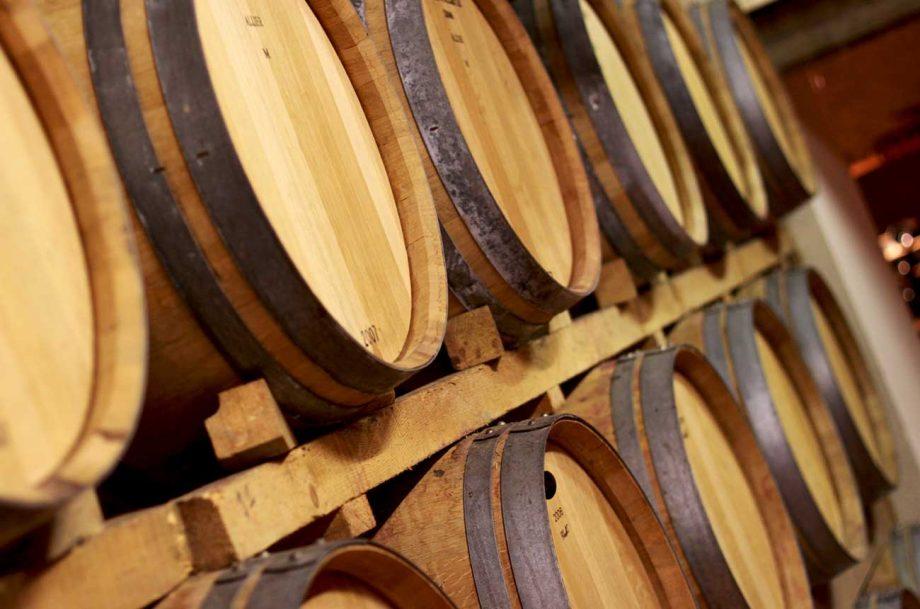 Bordeaux wine ageing in barrels in the cellars.