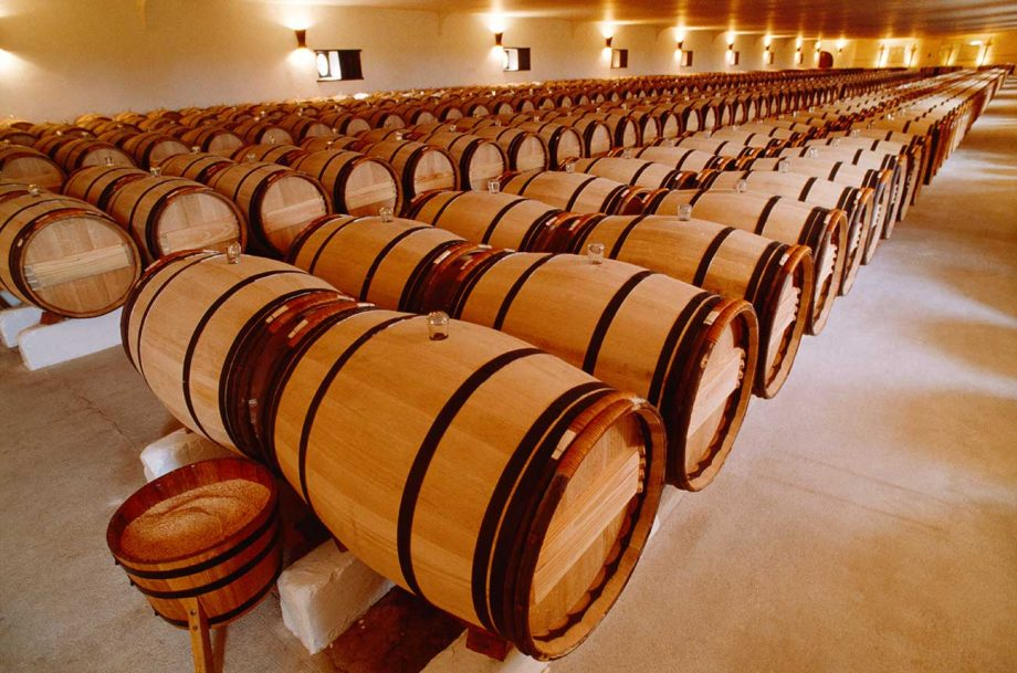 Barrels of wine ageing at Château Mouton Rothschild in Bordeaux.