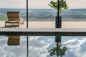 Swimming pool at Rpyal Champagne HOtel Spa overlooking vineyards
