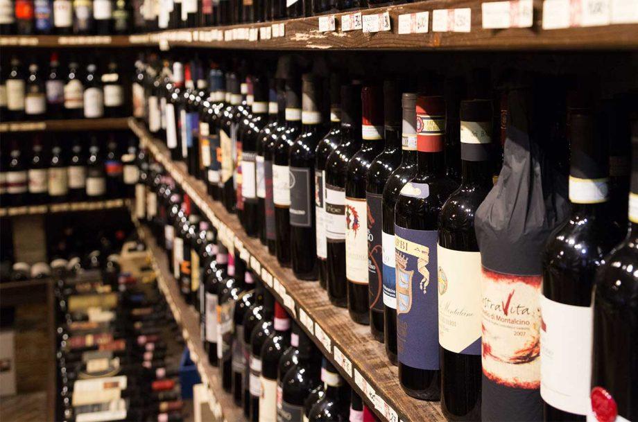 Bottles of wine on shop shelves
