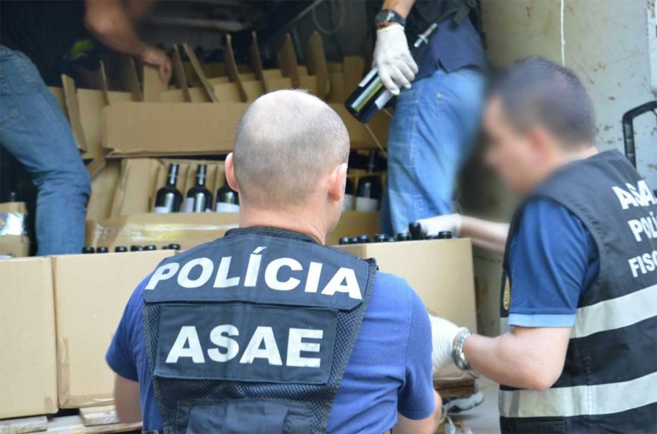 Suspected counterfeit wine being confiscated by police, as part of crackdown in Europe led by Europol in 2021.