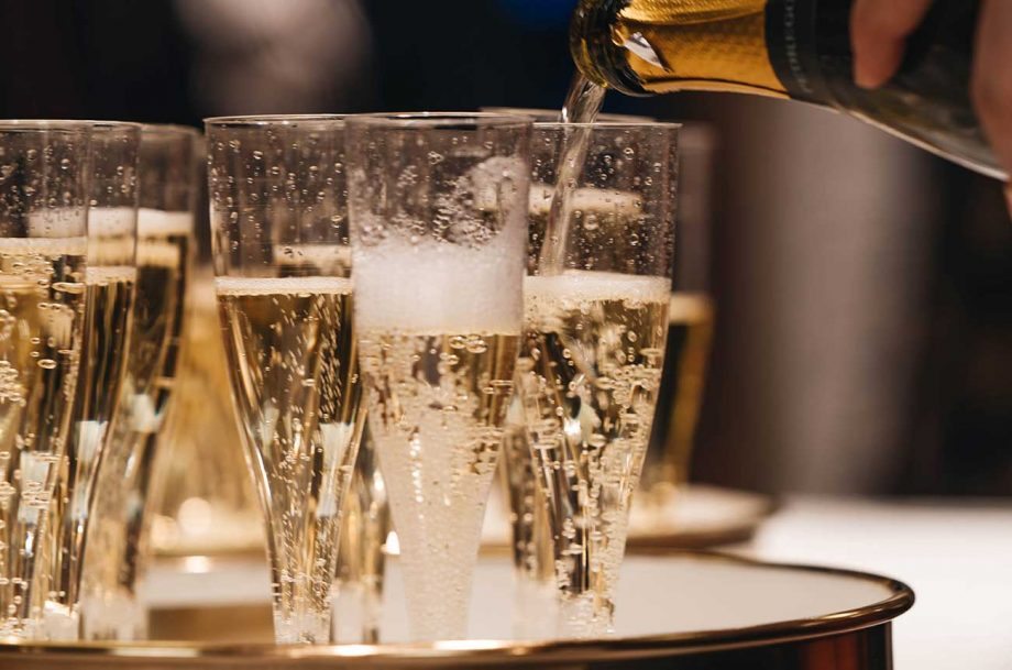 sparkling wine is poured into glasses