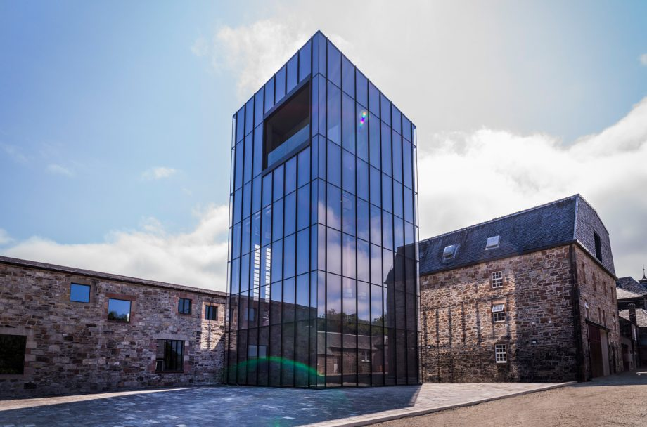 Exterior of the Glenmorangie whisky distillery building with new experimental distillery, the Lighthouse