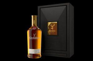 Bottle of Glenfiddich 1973 whisky against a black background