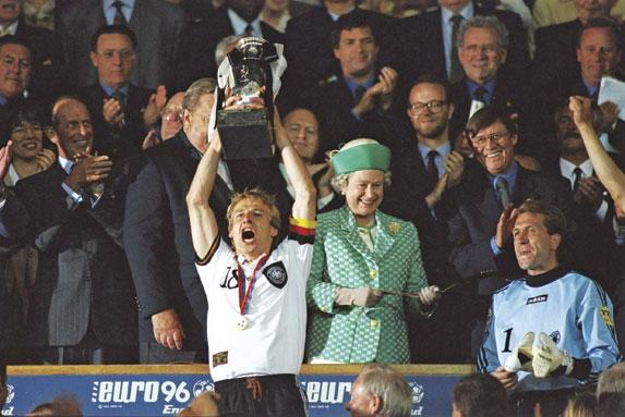 Jurgen Klinsmann lifts he trophy aloft