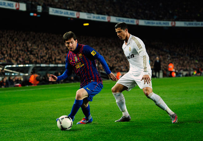 Lionel Messi shadowed by Cristiano Ronaldo