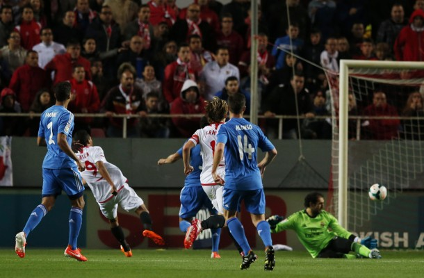 Sevilla's Carlos Bacca scores past Real Madrid's goalkeeper Diego Lopez during their Spanish First Division soccer match in Seville