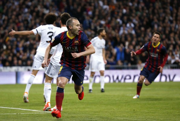 Barcelona's Iniesta celebrates a goal against Real Madrid during La Liga's second 'Clasico' soccer match of the season in Madrid