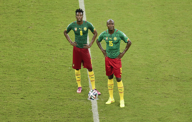 Cameroon's Benjamin Moukandjo, left, and Pierre Webo stand in the cente circle during the 4-0 defeat to Croatia.