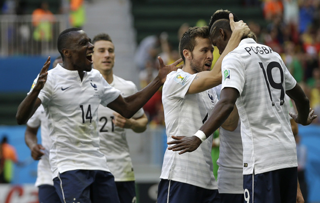 France celebrate Pogba's goal against Nigeria.