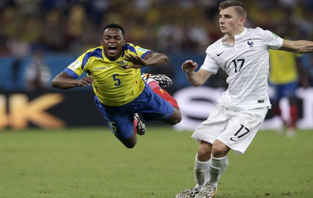 France's Lucas Digne trips Ecuador's Alex Ibarra