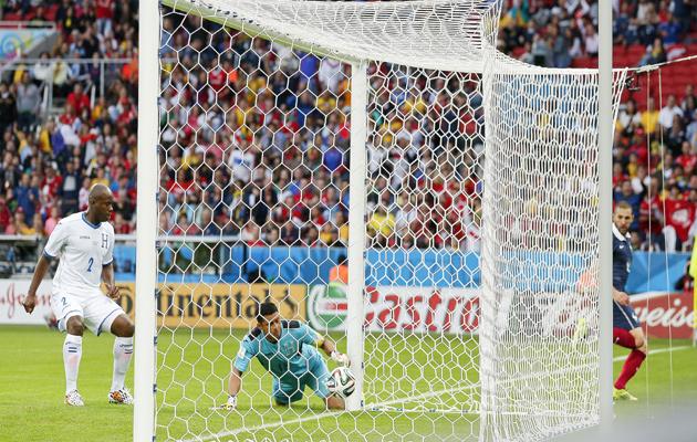 Honduras' goalkeeper Noel Valladares bundles a shot from France's Karim Benzema over the  line
