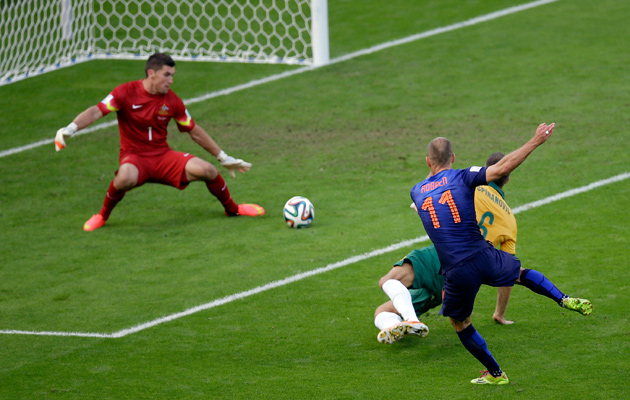Arjen Robben opens the scoring for Holland against Australia.
