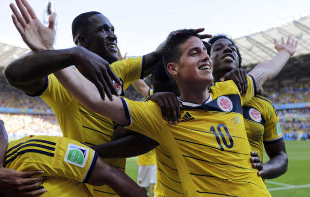Colombia players celebrate their third goal against Greece.