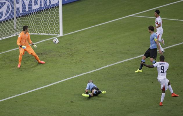 Costa Rica's Joel Campbell scores against Uruguay.