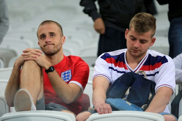 England fans are left dejected after the final whistle during the Group D match the Estadio do Sao Paulo, Sao Paulo, Brazil.